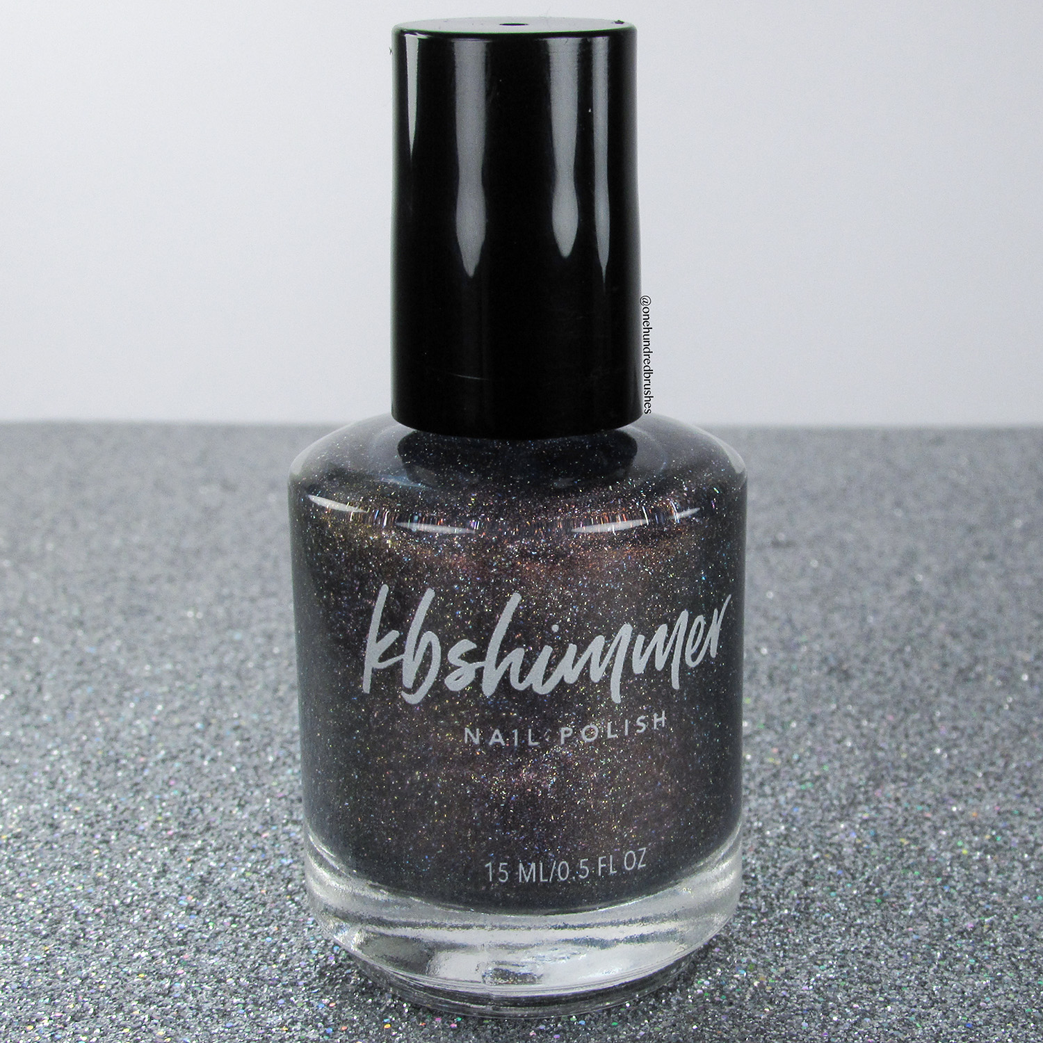 un-Staple - bottle, side - KBShimmer - May 2018 Polish Pickup - holographic - office space - 90's pop culture