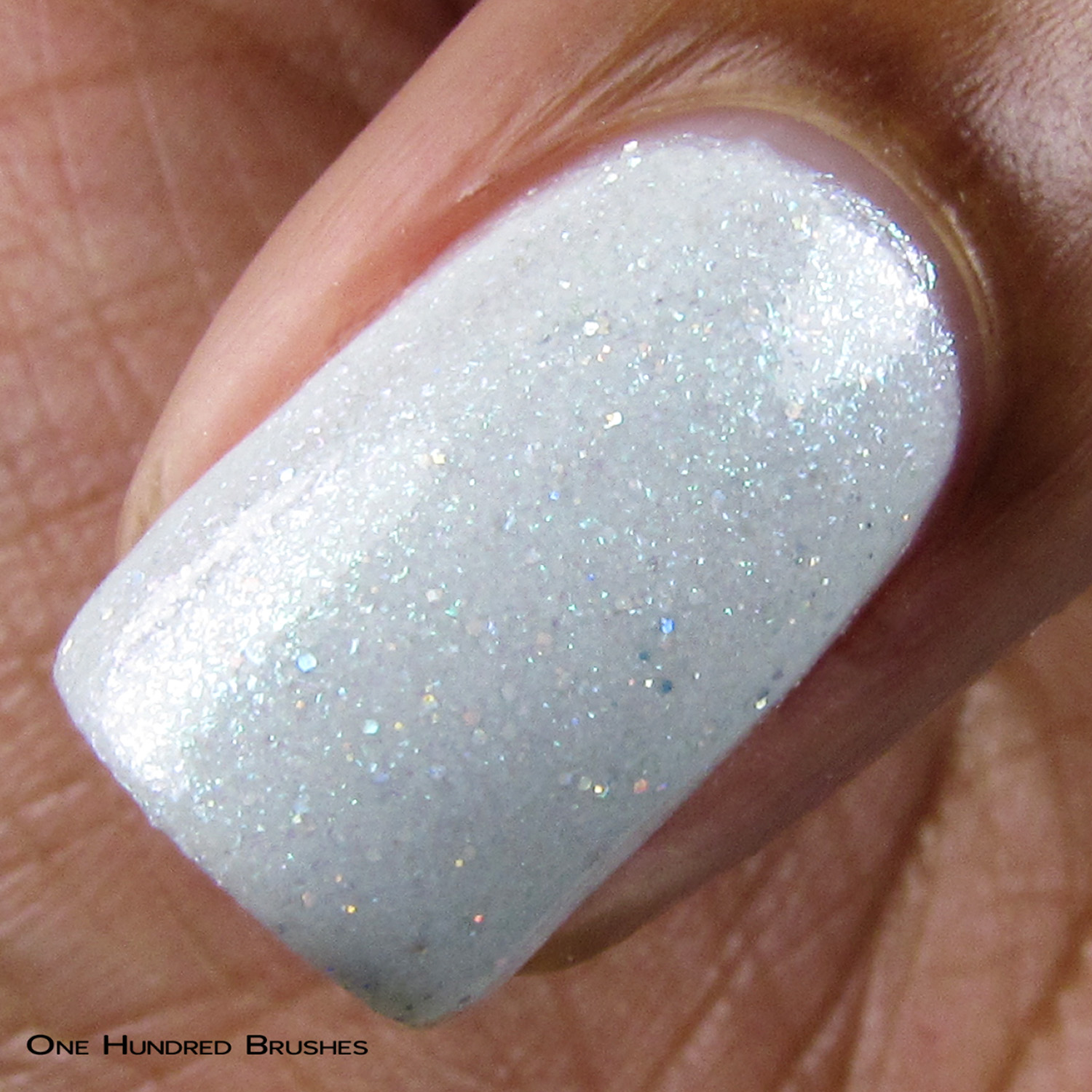 pale, cold blue with frosty green shimmers and scattered holographic glitters.